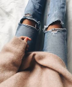 Oversized camel sweater and ripped jeans