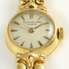 Vintage Swiss ladies yellow gold wrist watch by Patek Philippe. This watch features an 18 karat yellow gold case and bracelet with restored original silver dial and 18 jewel movement circa Case Ref Antique Watches, Vintage Watches, Jewely Organizer, Camping Gifts, Patek Philippe, Gold Watch, Bracelet Watch, Wrist Watches, Ladies Watches