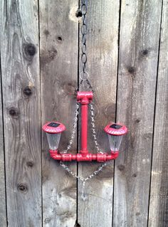 Red Solar Powered Outdoor Pipe Chandelier by SomeAssemblyInspired