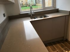 Coral Clay Silestone Quartz worktops installed by www.grosvenorgranite.co.uk