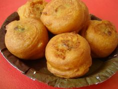 Mumbai's popular fast food snack, Batata Vada, is a deep fried indulgence. Spiced mashed potatoes are dipped in chickpea batter, deep fried to a golden shade and served with mint-coriander chutney or garlic chutney. When Batata Vada is sandwiched between green chutney smeared pav, it becomes a Vada Pav, another of Mumbai's famous street food snack.