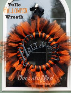 Gorgeous orange and black tulle Halloween wreath. Easy to make and makes a big impact. #overstuffedlife