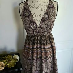 """NWOT Adorable Boho Inspired Sundress Super cute 100% cotton sun dress.  It has brown a cotton lining inside so it's not see through. The colors and patern of this dress are gorgeous and the fabric is so soft.   Measures about 53"""" in length  (which would alter a bit depending on breast size) 16"""" actoss bust   Perfect condition!!  Feel free to ask if you have any questions!! xo Dresses Maxi"""
