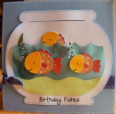 """The overall size of the card is 6 x 6  and the fish tank was cut out at 5"""" for the water part of the tank I used some blue vellum paper so that you could see through it.     All the fishes are cut out at 1"""" and little Sparkle Lights were used for the bubbles coming out of the water."""
