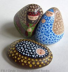 "A ""dotting"" technique was used to paint these nativity scene figures on small rocks"