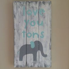 Love you tons Baby Nursery sign You choose the colors!! Handmade and hand painted reclaimed pallet wood sign. Size: approx 19 tall x 10 wide. Example Colors: Gray with whitewash background and light turquoise lettering. Current Processing Time is ****Ready to ship in 2-3 Weeks from purchase. Great addition to a Nursery or Childs Bedroom. Perfect gift for a Baby Shower or Birthday. *Comes from a smoke-free home.