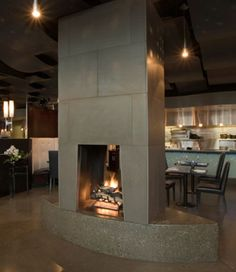 Modern-fireplaces-design-as-living-room-and-dining-room-partition-2 - Easy Decor