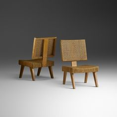 Lot 33: Pierre Jeanneret. Rare lounge chairs, pair. 1955, oak, rattan, cane. 19¾ w x 25½ d x 33 h in. estimate: $20,000–30,000. Provenance: Kunstzalen DeJong-Bergers, Maastricht | Maximiliaan Verboeket, Maastricht, acquired from the previous in 1955 | Private Collection, Maastricht | Private Collection, Amsterdam
