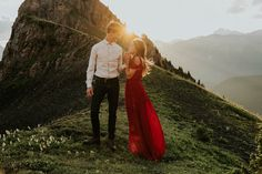 Mountain views + golden light + a red dress | Image by Célestine Aerden Photography