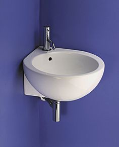 Small corner sink. I'm always looking for interesting shapes that can be used in very small spaces.