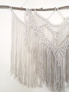 This large macrame wall hanging is made to order by Hanifah in Sydney, Australia. It is made with with thin rope to create a dainty look. This piece would be perfect to hang in the main room as a focal point. You can hang it above the lounge, entertainment unit or in the bedroom above the bed.