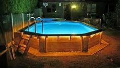 Another great above ground pool idea fro covering the outside of it.  Above Ground Pools Decks Idea - Bing Images