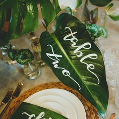 hand-lettered tropical leaf table number