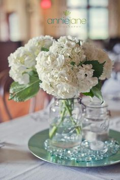 mason jar centerpieces with only white flowers