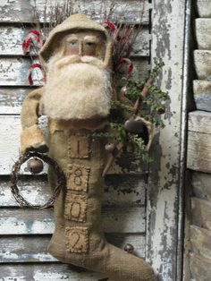 Primitive Santa in a stocking with address on it Primitive Christmas Decorating, Primitive Santa, Prim Christmas, Primitive Crafts, Father Christmas, Country Christmas, Winter Christmas, All Things Christmas, Handmade Christmas
