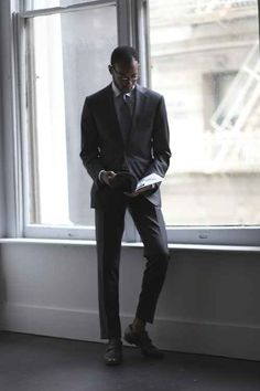 Opt for a charcoal or gray suit over black, unless you're attending a funeral.