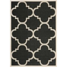 Grace your home with this black indoor/outdoor rug from Safavieh. This bold rug features a beige border, geometric pattern, and thick pile. Constructed from polypropylene material, this power-loomed piece is also resistant to mold and mildew.