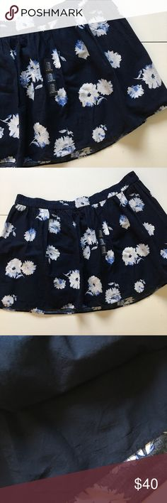 """NWT Gap Navy Floral Skirt Brand new with attached tags. Elastic waist. Fully lined. Measures 22"""" across waist, 17"""" total length. GAP Skirts"""