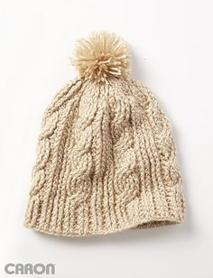 One sized crochet cabled hat with pom pom to fit average adult woman Beautiful post stitching and pom pom finish
