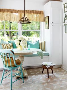 Built-In SeatingBuilt-In Seating Whether it's a cozy window seat in the living room or a cheerful bench in the breakfast room, a built-in seating nook is the perfect complement to the informal nature of cottage style. A rustic table and charming vintage chairs pull up to this built-in bench to create a casual and inviting eat-in kitchen.