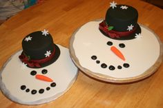 Melted snowman - I saw this done by a member here on cake central. I have to give all the credit to them. I did these for my daughters school parties. They were a big hit. Cake hat, melted fondant and gumpaste details.