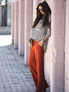 Pair wide leg trousers and button-down blouse for this look.