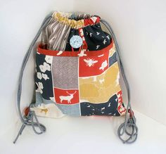 Drawstring Backpack with Pocket | Sew Mama Sew | Outstanding sewing, quilting, and needlework tutorials since 2005.