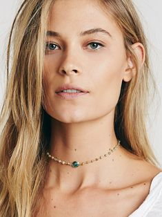 Libi Stone Choker   Handmade in NYC, this delicate necklace features semiprecious stones and faceted center stone. Clasp closure.   *By Ela Rae