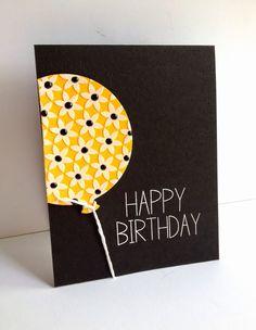 Yellow balloon on black