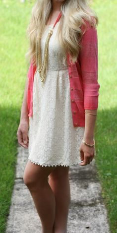 Wear a pink cardigan and a cream lace skater dress to create a chic, glamorous look.   Shop this look on Lookastic: https://lookastic.com/women/looks/pink-cardigan-beige-skater-dress-gold-necklace-gold-bracelet/11557   — Gold Necklace  — Beige Lace Skater Dress  — Pink Cardigan  — Gold Bracelet