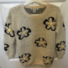 Furry Flower Sweater Cute furry flower sweater in ivory color perfect for this fall and winter. Just wore a couple times. In excellent condition. Sans Souci Sweaters Crew & Scoop Necks