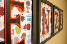 Cute inexpensive idea for name wall art - cheap ikea frames, scrapbook paper, lasercut letter papers overtop.