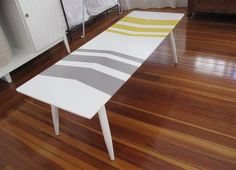 "Beautiful, one-of-a-kind, refinished mid-century modern coffee table. Simple, classic, clean-lined style. Solid wood with two fresh coats of semi-gloss paint. Gray and yellow chevron pattern, hand-painted on a white background. The table measures: 48""W x 17 1/2""D x 15 1/2""H. $200 best offer."