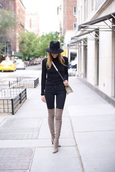 """Neutral coloured over the knee boots will look great paired with an all black outfit. Via Lisa D Cahue. Turtleneck: Velvet, Jeans: DL 1961, Hat: Rag & Bone, Boots: Stuart Weitzman """"Highland""""."""