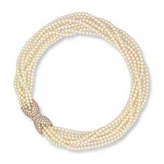 A CULTURED PEARL AND DIAMOND NECKLACE, BY VAN CLEEF & ARPELS Composed of eight rows of round white cultured pearls measuring from approximately 3.6 to 4.0 mm, to the brilliant and baguette-cut diamond foliate clasp, mounted in 18k gold