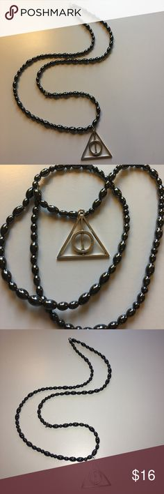 🆕Harry Potter's deathly hallows hematite necklace New Harry Potter deathly hallows us necklace with precious gemstones of hematite🌀 hematite Gemstones are used to ward off evil.. as they say . The necklace is 23 & 1/2 inches long. Same day next day shipping📬 bundle for 10% off 🛍 Harry Potter  Jewelry Necklaces