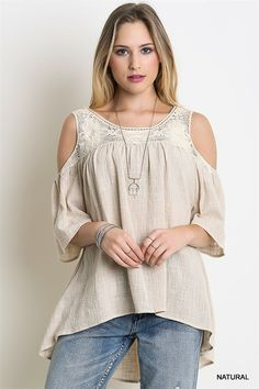 65% cotton, 35% polyester. Natural texture fabric. Short sleeves, Loose fit, with beautiful country lace neckline and shoulder straps... Casual wear at it's best. You can dress this up or down, it is