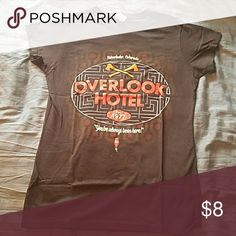 The Shining Overlook Hotel T-Shirt All work and no play makes Jack a dull boy. ? Brown, short sleeve tee featuring Stephen King's infamous Overlook Hotel from The Shining with predominantly red-orange text. Never worn. Comes from a smoke-free home. Comment if you'd like to bundle with another item. :) Tops Tees - Short Sleeve