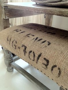 Upcycle.! The use of burlap sacks and tacks can be used to reupholster a bench.