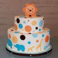 mama and baby animals around the base of a lion cake