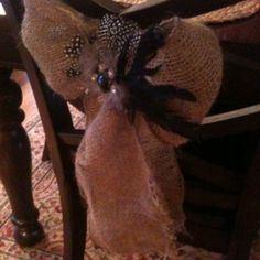 Burlap chair bow with feather and rhinestone clip