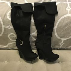 Colin Stuart knee high wedge boots Colin Stuart knee high wedge boots in black. Worn once. Bought from Victoria's Secret. Excellent condition. Beautiful boots, only selling because I find them difficult to walk in. Material is not real leather but it feels like soft lamb skin. Boots do not come with original box(I never received one) Colin Stuart Shoes Heeled Boots