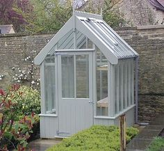 I love this little wooden greenhouse but you'd grow out of it in 5 minutes!