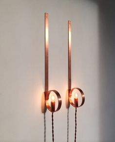 Copper wall-mounted lighting by Studio Spruzzi.