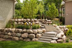 Two tiered boulder backyard boulder wall terraces. Two tiered boulder backyard boulder wall terraces Sloped Backyard Landscaping, Landscaping With Boulders, Terraced Landscaping, Landscaping On A Hill, Sloped Yard, Landscaping Retaining Walls, Landscaping Ideas, Terraced Backyard, Flagstone Patio