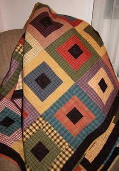 Stepping Stones pattern - love the colors of the homespun fabric in this quilt; black fabrics were used for the the centers....
