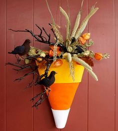 Craft a Simple Candy-Corn Door Decoration for Halloween  {Better Homes and Gardens} #halloween #craft