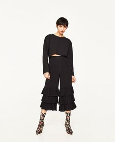 TROUSERS WITH FRILLS