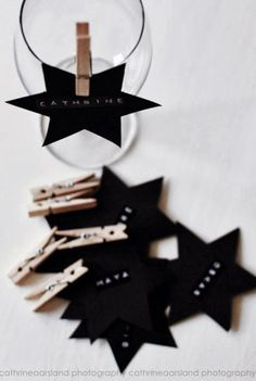 Black star place names, peg onto glasses at the table. #monochrome #star