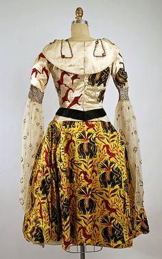 Fancy dress costume  Léon Bakst (Russian, Grodno 1866–1924 Paris)  Designer: Textile by Raoul Dufy (French, Le Havre 1877–1953 Forcalquier) Date: 1919 Culture: American Medium: silk, glass, plastic